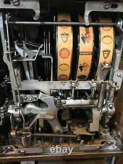 Jennings Chief Slot Machine & Mills War Eagle Slot machines & Ornate oak stand